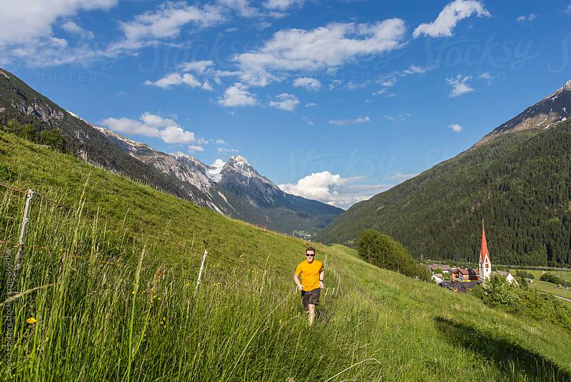 Runner in the mountains of Austria in spring by Soren Egeberg for Stocksy United
