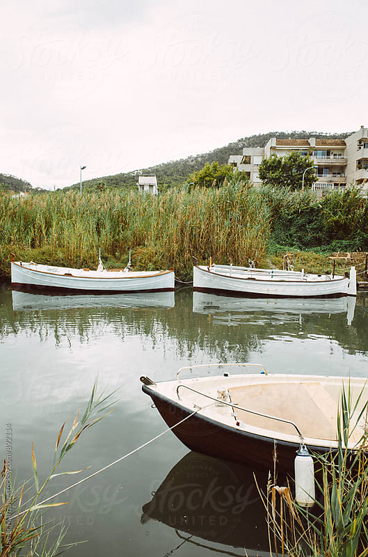 Boat in a lake by Javier Marquez for Stocksy United