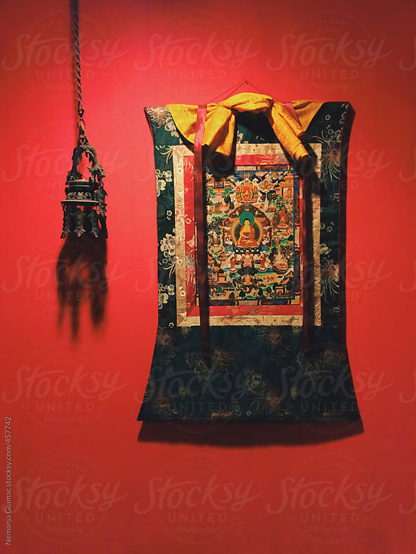 Buddhist Mandala on a Red Wall by Nemanja Glumac for Stocksy United
