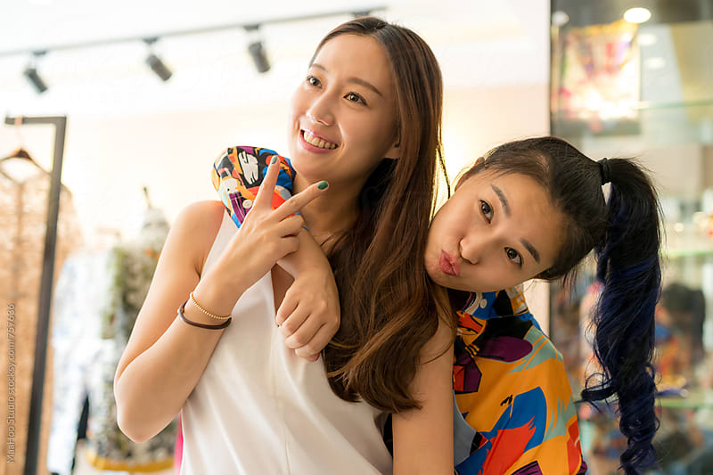 Two young fashion girl shopping at clothing store by MaaHoo Studio for Stocksy United