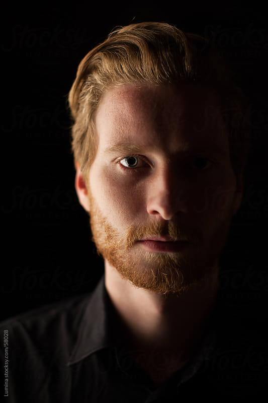 Dark Portrait of a Caucasian Man by Lumina for Stocksy United
