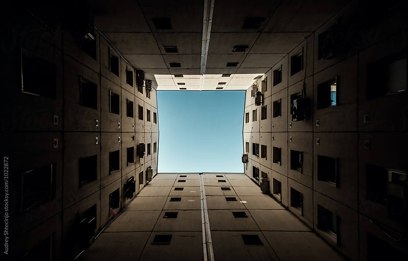 Minimalist architecture building in perspective with sky in center.