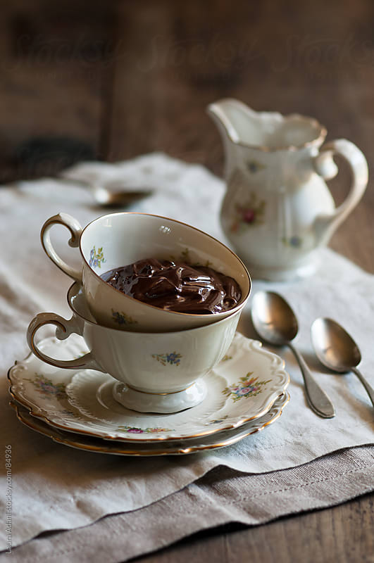 a tea cup full with a chocolate cream  by Laura Adani for Stocksy United