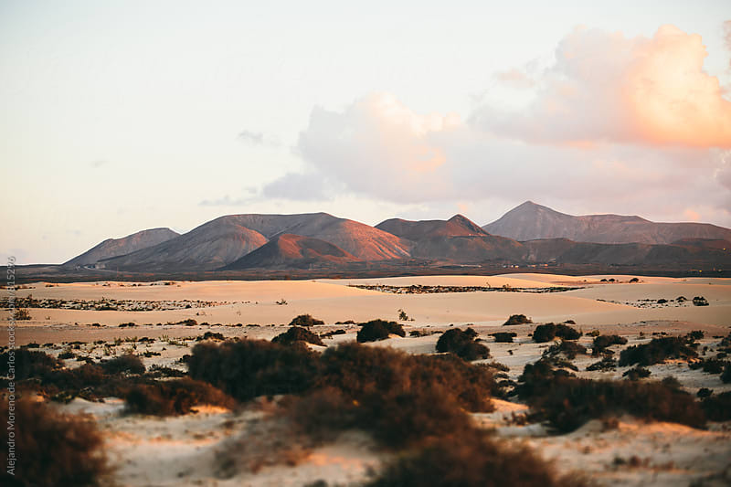 Desert landscape with mountains at sunset by Alejandro Moreno de Carlos for Stocksy United