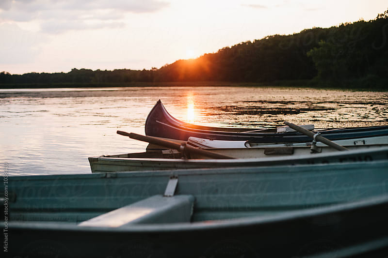Canoes on a Lake by Michael Tucker for Stocksy United