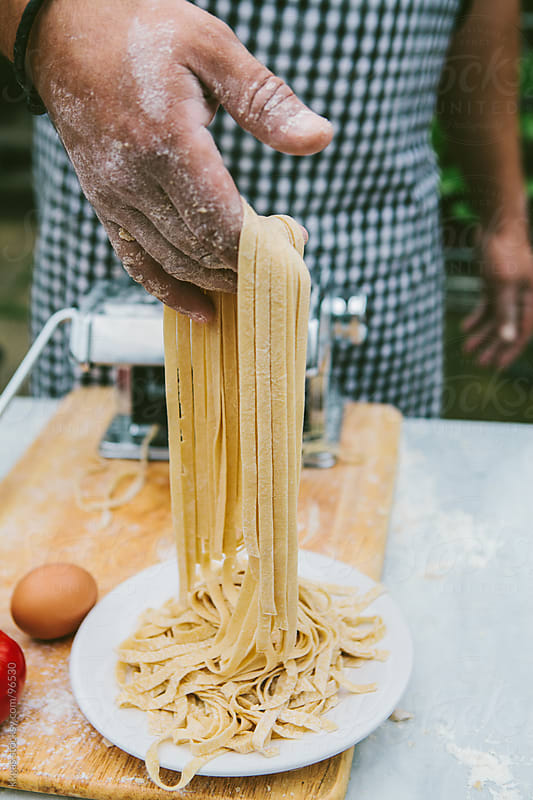 Man making fresh pasta with organic ingredients. by kkgas for Stocksy United