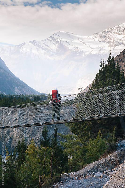 A lone trekker taking a break and enjoying the scenic view. by Shikhar Bhattarai for Stocksy United