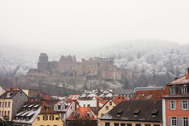 Ruins of a German castle surrounded by a frost-covered hillside  by Holly Clark for Stocksy United