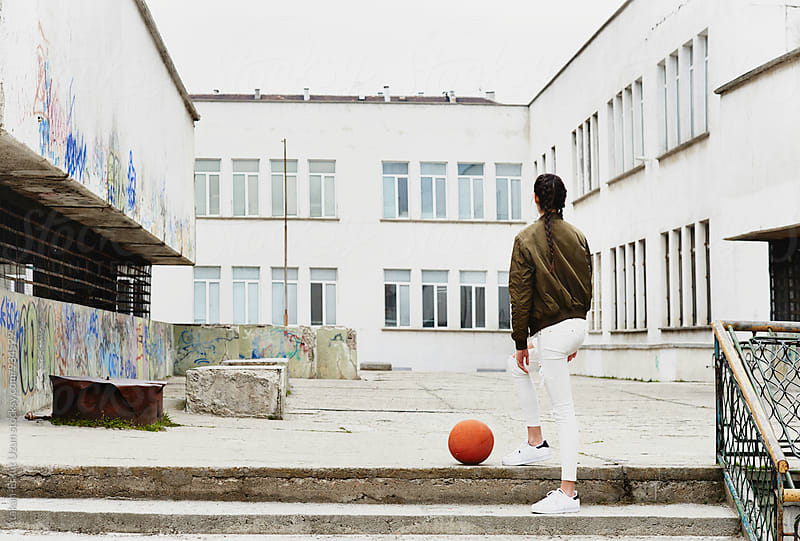 Young model posing with basketball  by Atakan-Erkut Uzun for Stocksy United