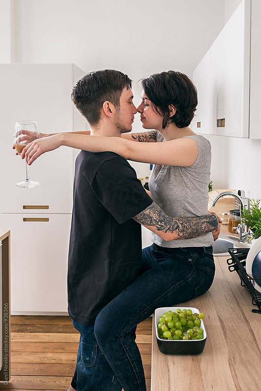 Beautiful couple hugging in kitchen by Danil Nevsky for Stocksy United