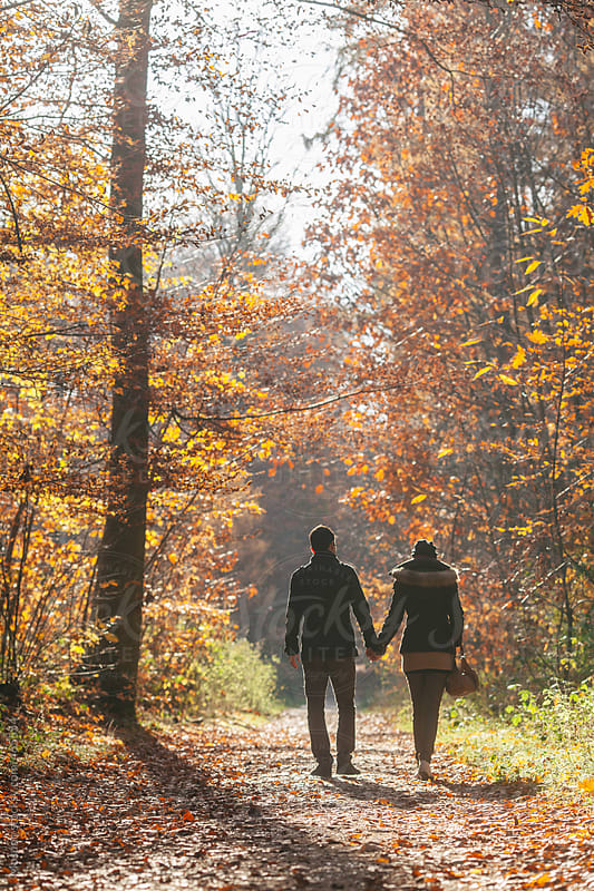 Young Couple Walking in the Forest  by Mosuno for Stocksy United