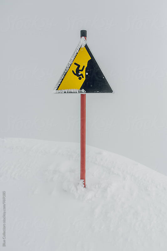 Dangerous cliff Signal in a ski resort by Jordi Rulló for Stocksy United