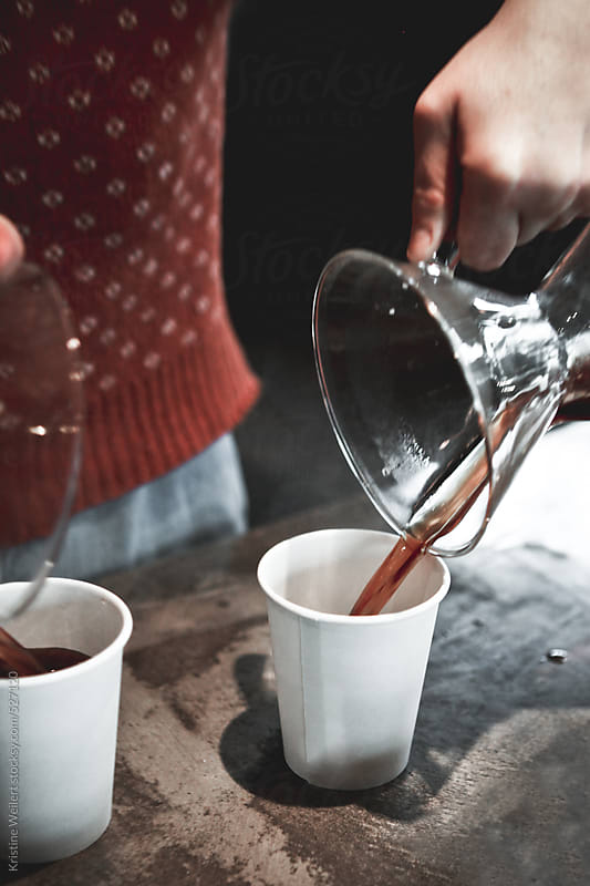 Barista pouring coffee pour overs into a cup by Kristine Weilert for Stocksy United