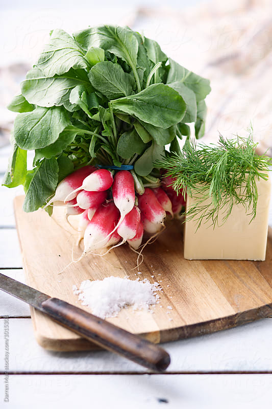 Radishes, butter,dill and salt on a cutting board. by Darren Muir for Stocksy United