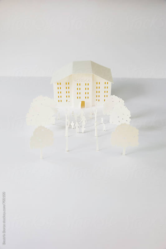 School on white in the city, conceptual photo of education by Beatrix Boros for Stocksy United