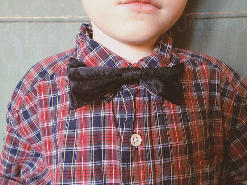 close up of child wearing bowtie by Jess Lewis for Stocksy United