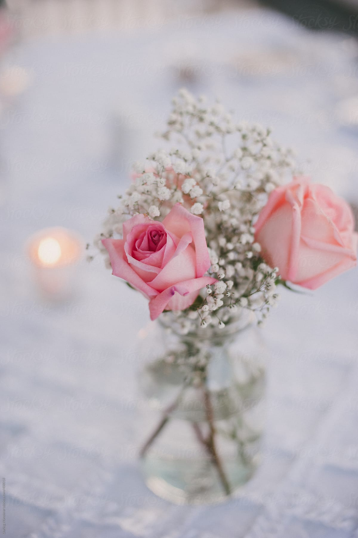 Simple babys breath and pink rose flower arrangement in mason jar simple babys breath and pink rose flower arrangement in mason jar by daring wanderer for stocksy izmirmasajfo