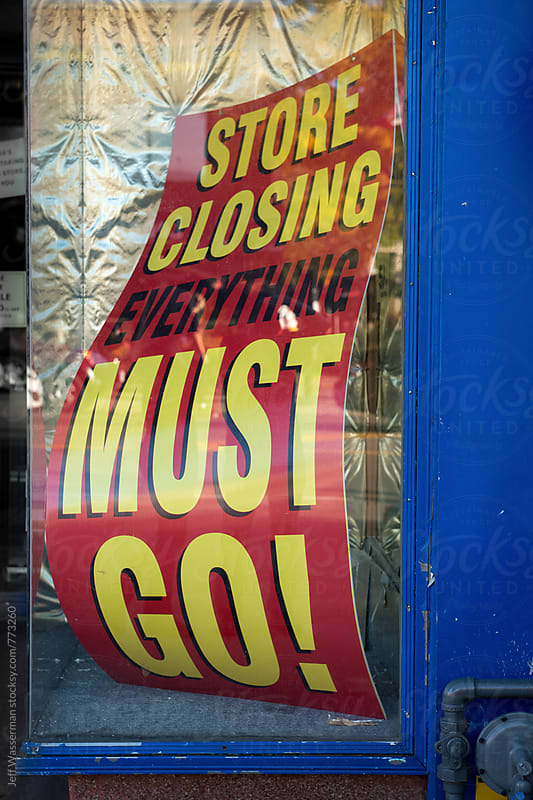 Store Closing Sign in Store Window by Studio Six for Stocksy United