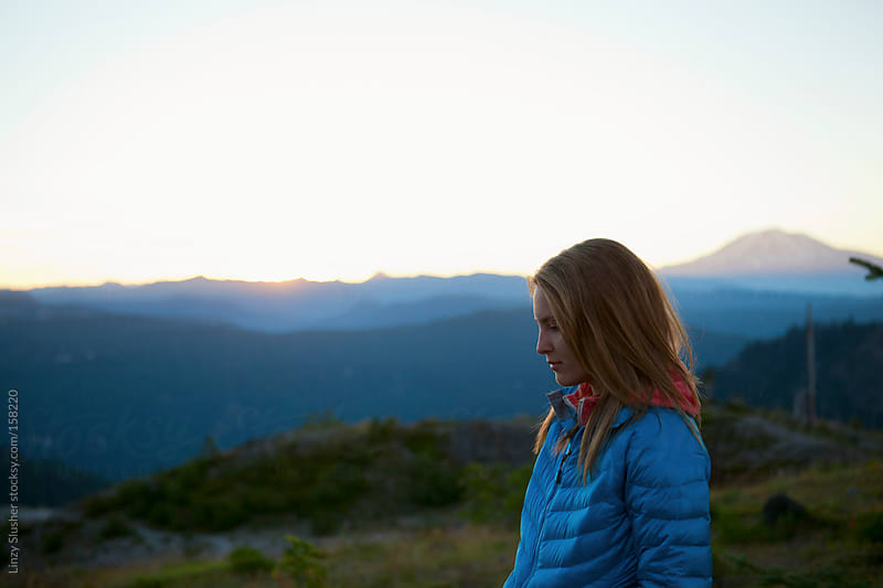 Female camper at sunrise by Linzy Slusher for Stocksy United