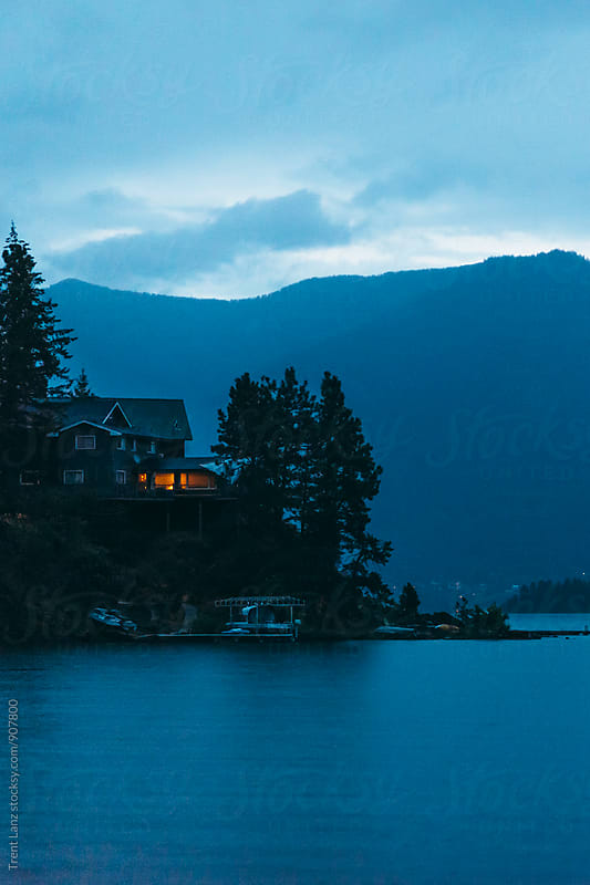 View of house on point at lake in Idaho at twilight by Trent Lanz for Stocksy United