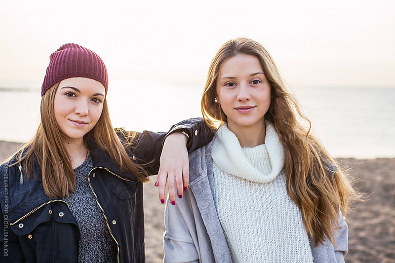 Portrait of young women standing on the beach at morning. by BONNINSTUDIO for Stocksy United