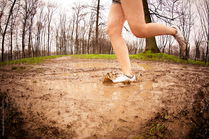 Woman jogging in the park on a rainy spring day. by Mosuno for Stocksy United