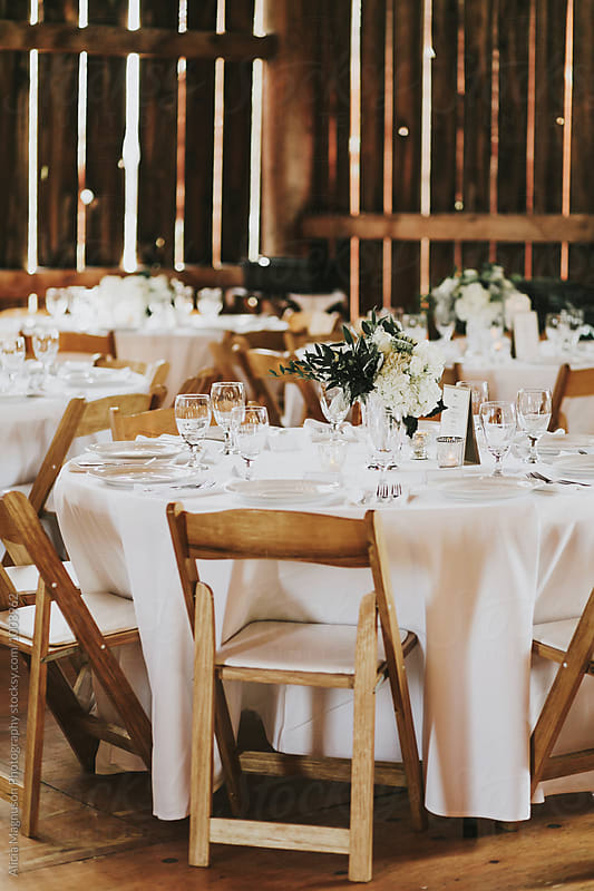Wedding Reception Table in Barn Reception Venue by Alicia Magnuson Photography for Stocksy United