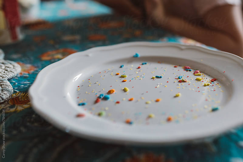 Plate with colorful sprinkles by Carey Shaw for Stocksy United