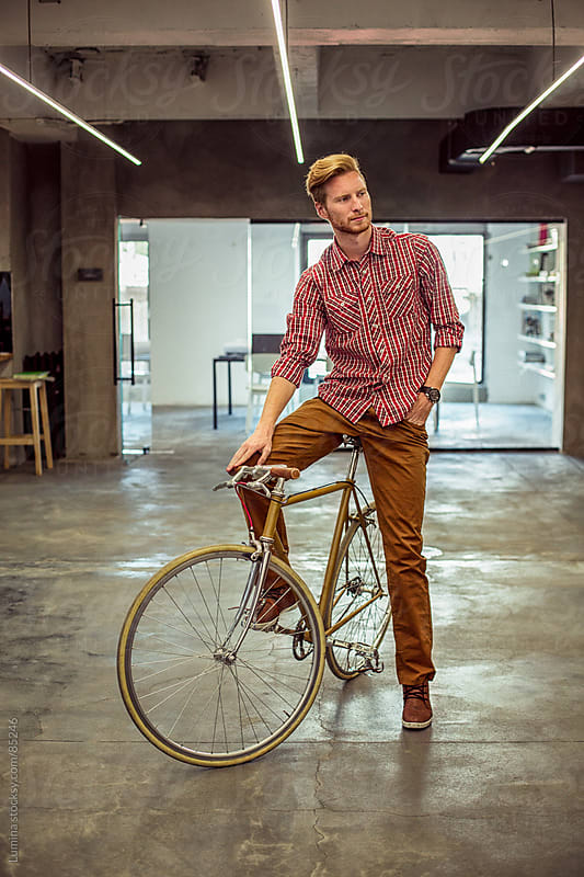 Cool Businessman on a Bicycle by Lumina for Stocksy United