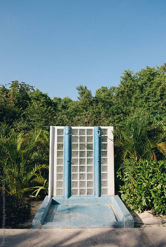Outdoor shower for tourists to wash off the sand after visiting the beach by Emmanuel Hidalgo for Stocksy United