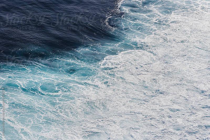 Foamy ocean surface after a big wave breaking by Jovana Milanko for Stocksy United