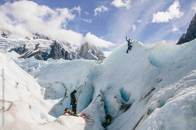 Man climbing on ice wall on a glacier in Patagonia, Argentina. Adventure sport by Alejandro Moreno de Carlos for Stocksy United
