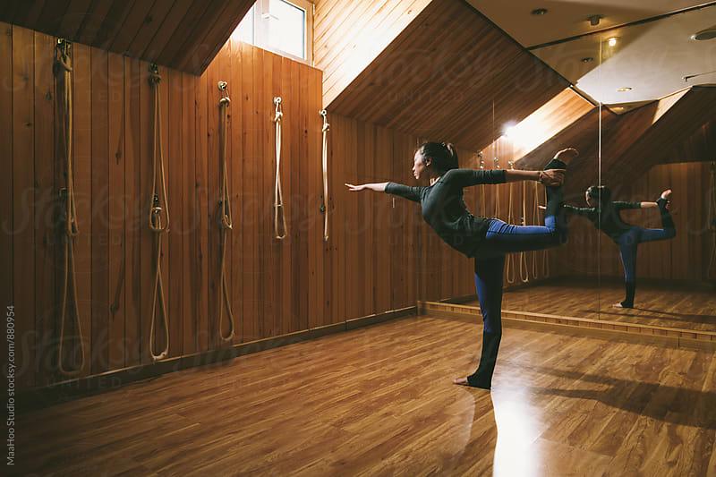 Woman practicing yoga by MaaHoo Studio for Stocksy United