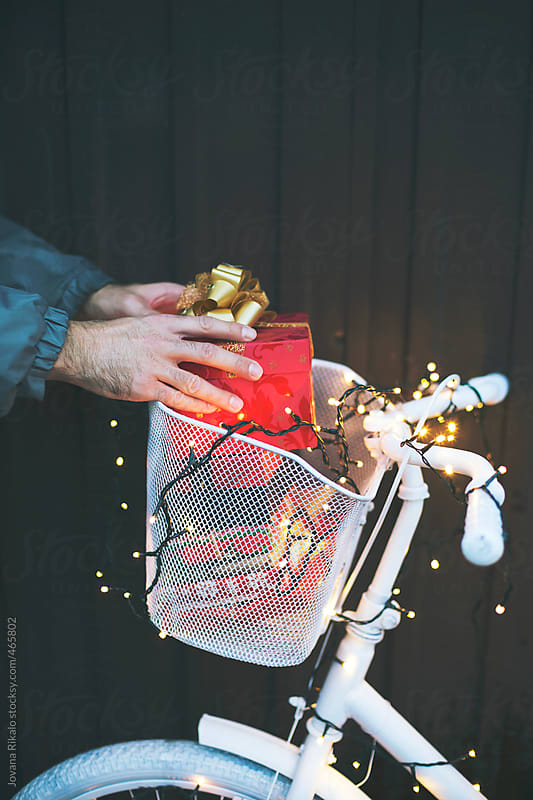 Man taking gifts by Jovana Rikalo for Stocksy United