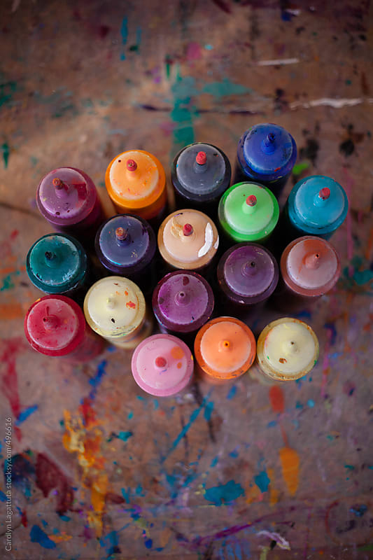 Overhead shot of many bottles of paint - all colors by Carolyn Lagattuta for Stocksy United