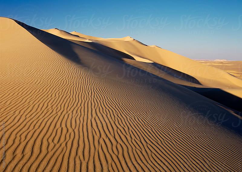 Sanddunes of the Sahara Desert by Hugh Sitton for Stocksy United