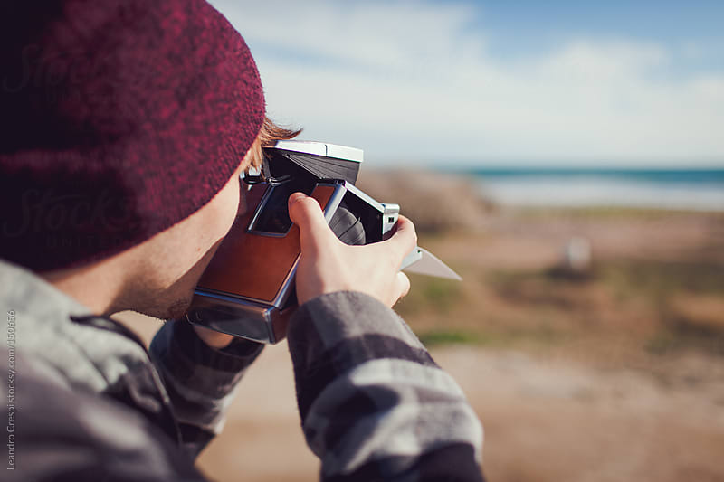 Photographer with old instant camera by Leandro Crespi for Stocksy United