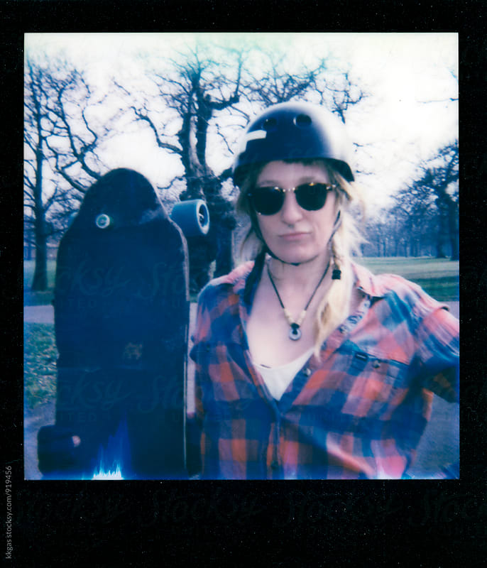 Portrait of a cool young woman longboarder with her board by kkgas for Stocksy United