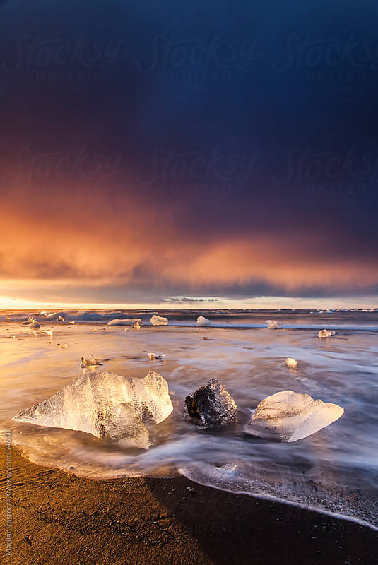 Sunrise on the beach Jokulsarlon in Iceland by Marilar Irastorza for Stocksy United