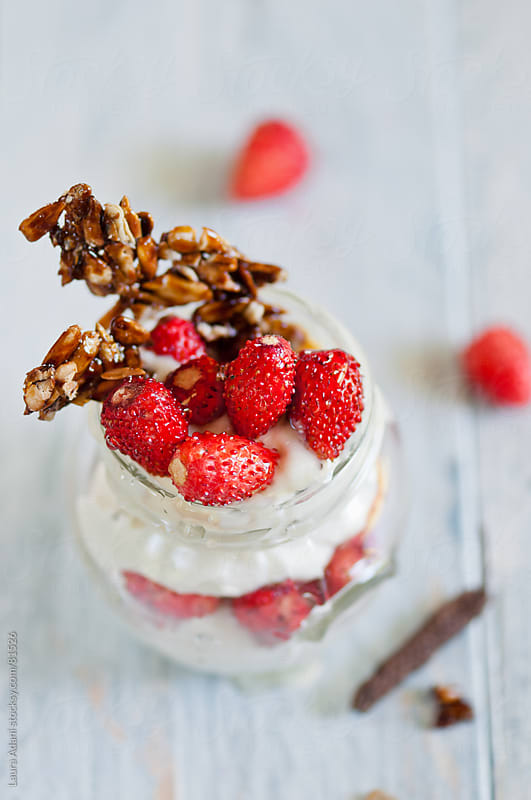 ricotta cheese cream with honey, long pepper and wild strawberries by Laura Adani for Stocksy United