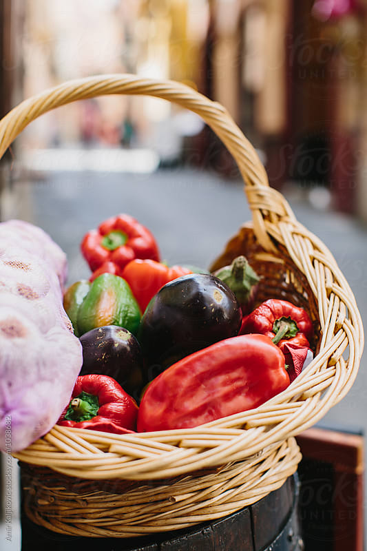 Hot and sweet peppers in fancy basket by Amir Kaljikovic for Stocksy United