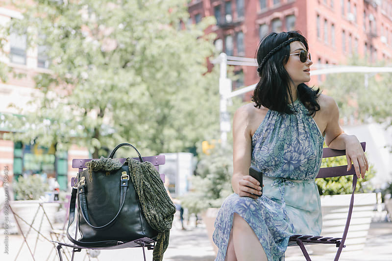 Woman in Sundress and Sunglasses in Urban street Park by Joselito Briones for Stocksy United