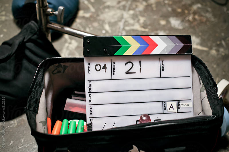 Clapboard sitting in a tool bag on a film set by Kristine Weilert for Stocksy United