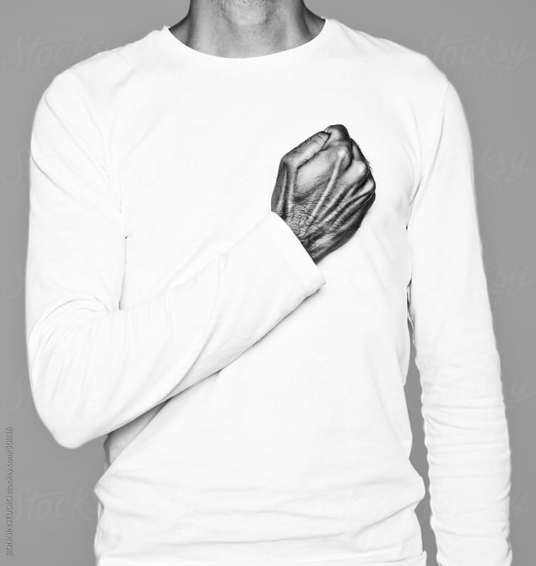 Man making the shape of a heart with his hand. Black and white. by BONNINSTUDIO for Stocksy United