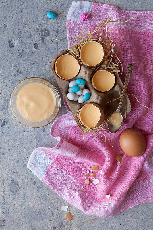 Easter holiday fun - custard served in eggshells by Nadine Greeff for Stocksy United