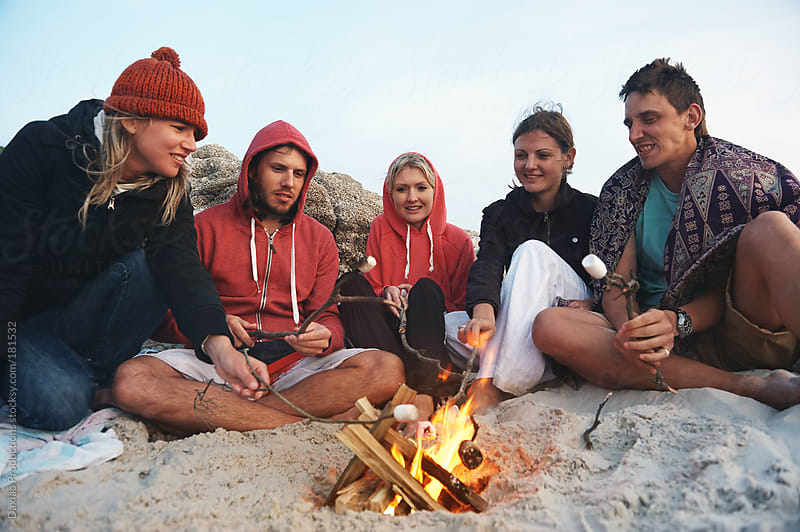 beach bonfire marshmallow by Daxiao Productions for Stocksy United