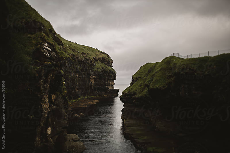 Natural Harbor and Cliffs on the Atlantic Ocean in Gjogv, Faroe Islands by Rachel Gulotta Photography for Stocksy United