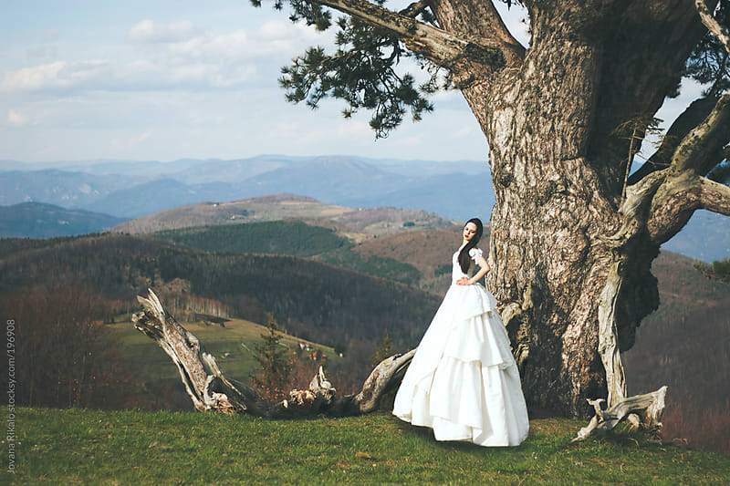 Beautiful woman posing in a wedding dress  by Jovana Rikalo for Stocksy United