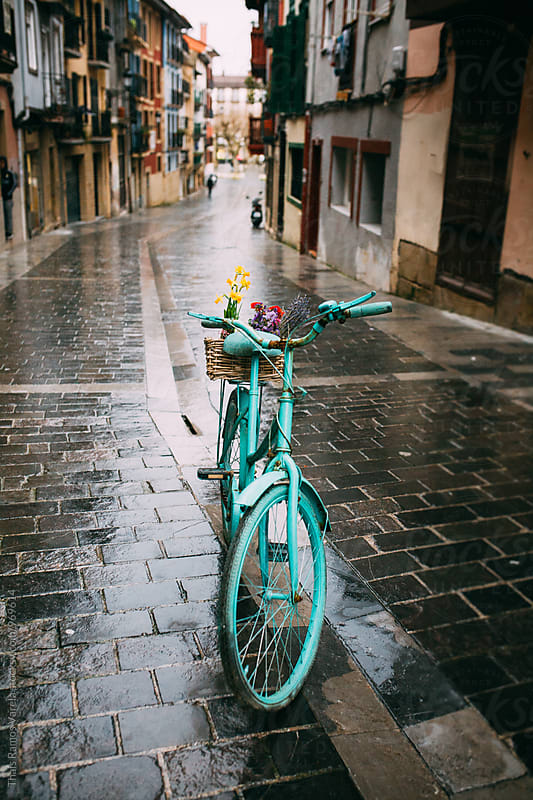 blue bicycle by Thais Ramos Varela for Stocksy United