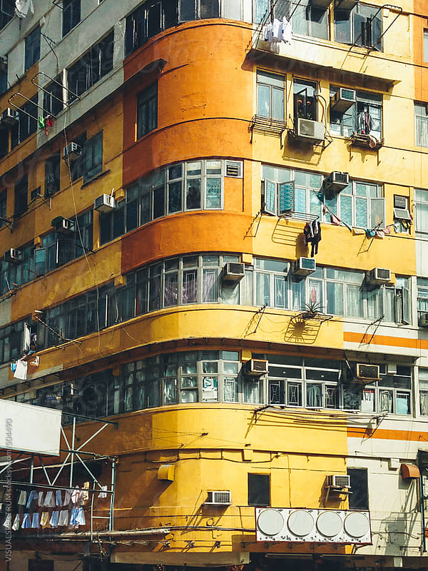 Yellow Building Facade in Hong Kong by VISUALSPECTRUM for Stocksy United